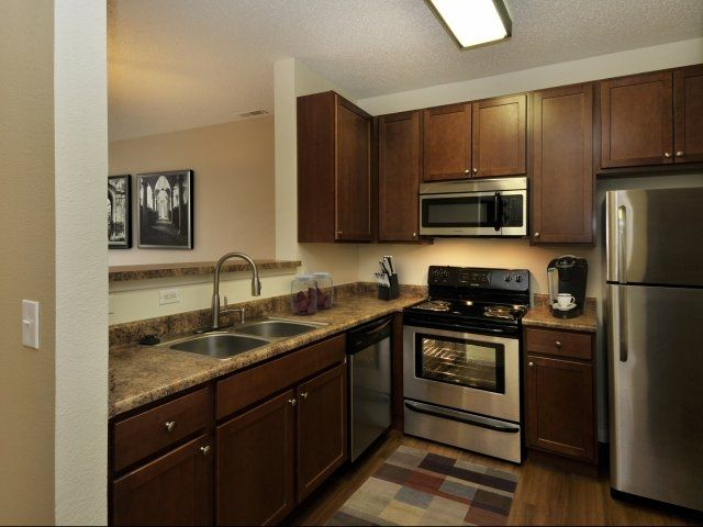 Apartments With Dark Wood Finished And Updated Appliances. The Grande  Reserve At Giest In Indianapolis, IN With 2 And 3 Bedroom Apartments For  Rent.