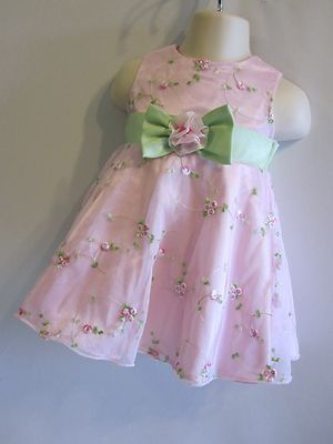 A sage green sash with a pink silk flower can make a plain pink dress into a beautiful shabby chic outfit perfect for a tea party.