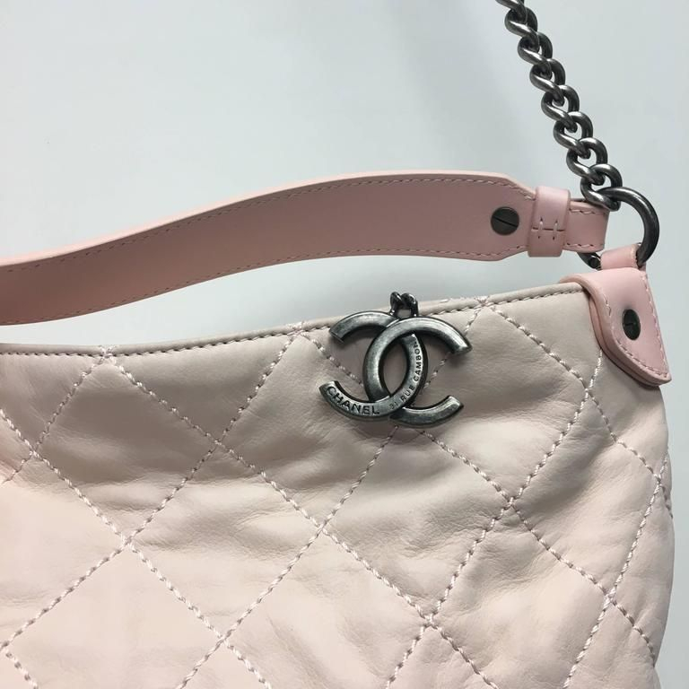 CHANEL Light Pink Quilted Calfskin Leather Coco hobo bag from the 13C  collection. Relaxed and e5995ddd0b