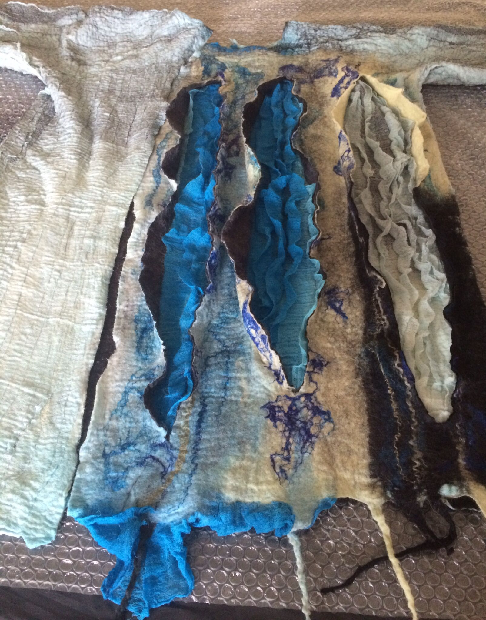 Blue felted vest with 3D decor by Nadin Smo design.  www.nadinsmo.com