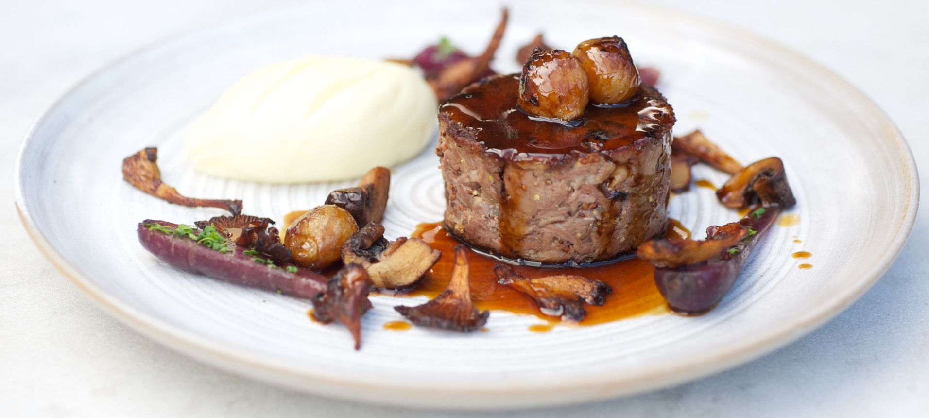 Braised Shin of Beef with Button Onions and Mushrooms