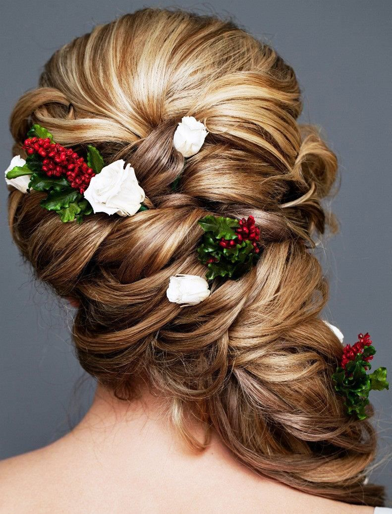 bride's loose chignon side braid with flowers bridal hair