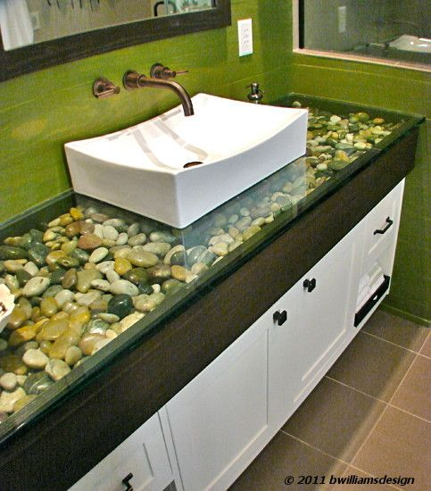 """1"""" glass counter-top with river rock fill. Love the green stained walls....I would LOVE to have this bathroom"""