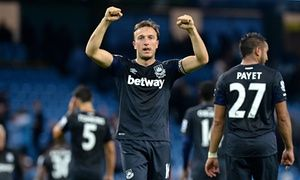 Mark Noble celebrates after the final whistle.