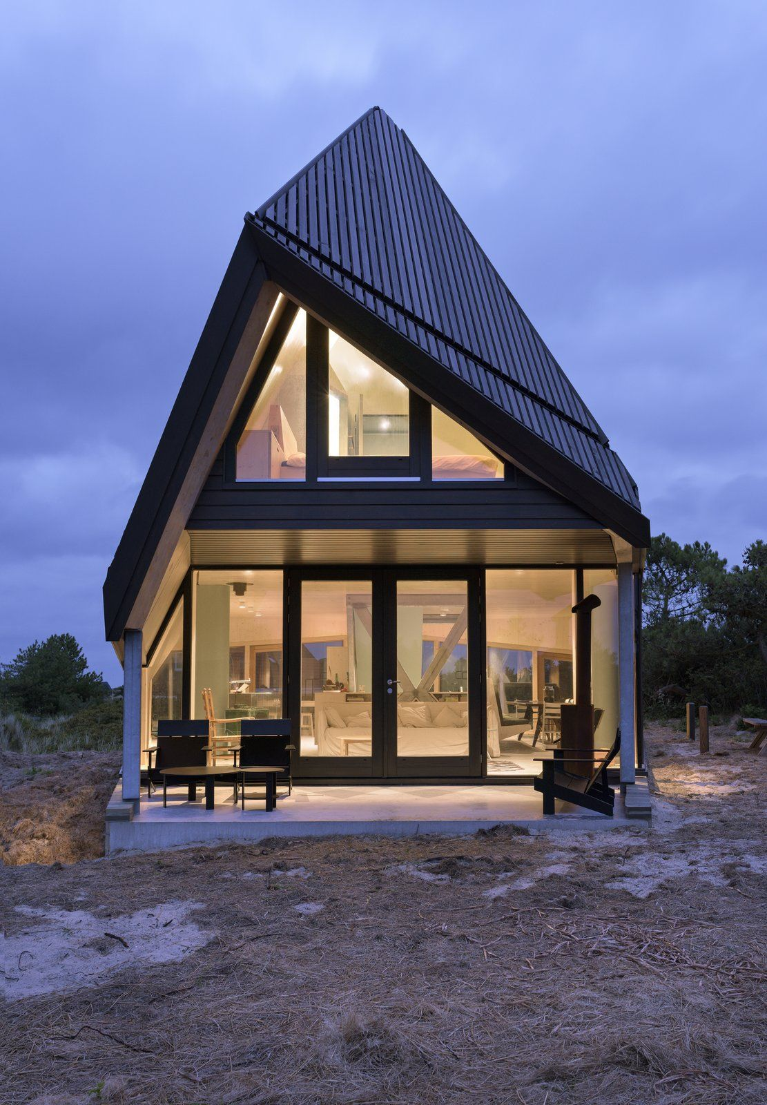 A Tent Shaped Home In The Netherlands Crouches Between Natural Dunes Roof Architecture House Roof Design Architecture