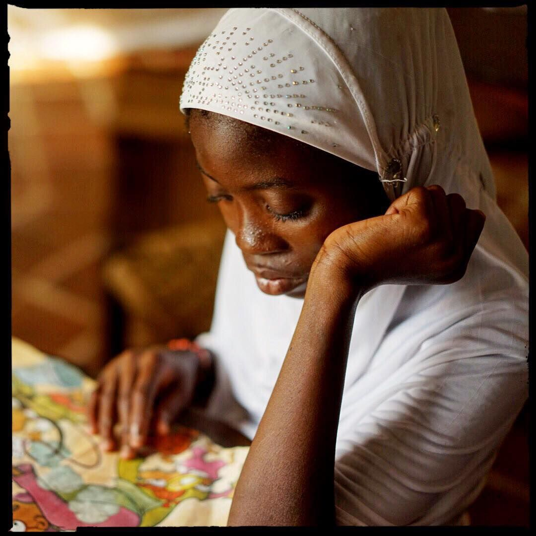 Going through life without education is like traveling on a stationary bike. Now matter how hard you sweat, you still stay at the same place.  A girl reads quietly in the Nima Library. Accra, Ghana.  Photo and words by Nana Kofi Acquah @africashowboy @alueducation #AfricaInspired #Ghana #Nima #Muslim #Africa #ALA