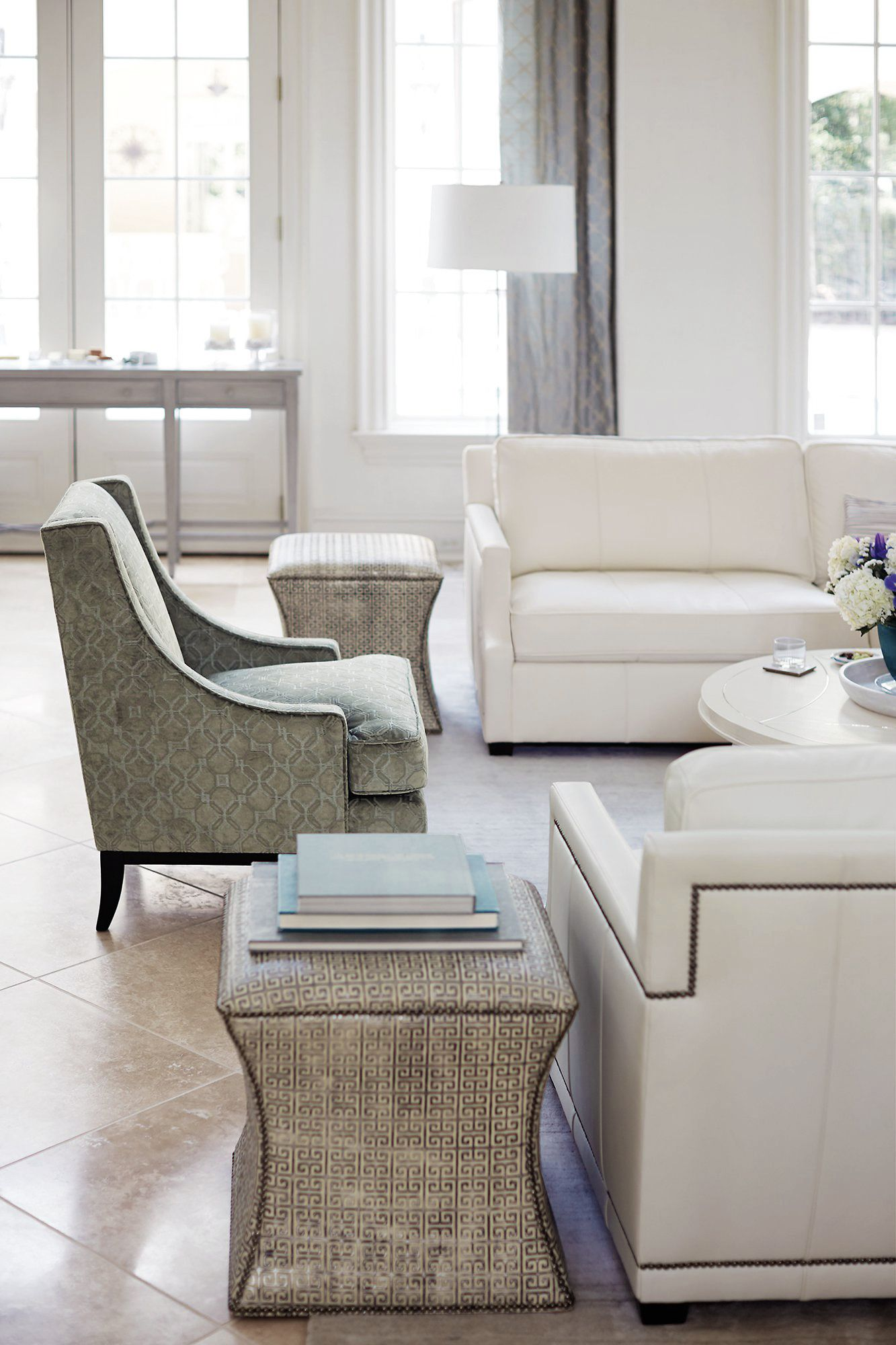 Transitional Dining room. Patterned ottoman, slope arm chair, white ...