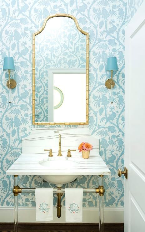 Camille Long Sconces accented with blue shades flank a