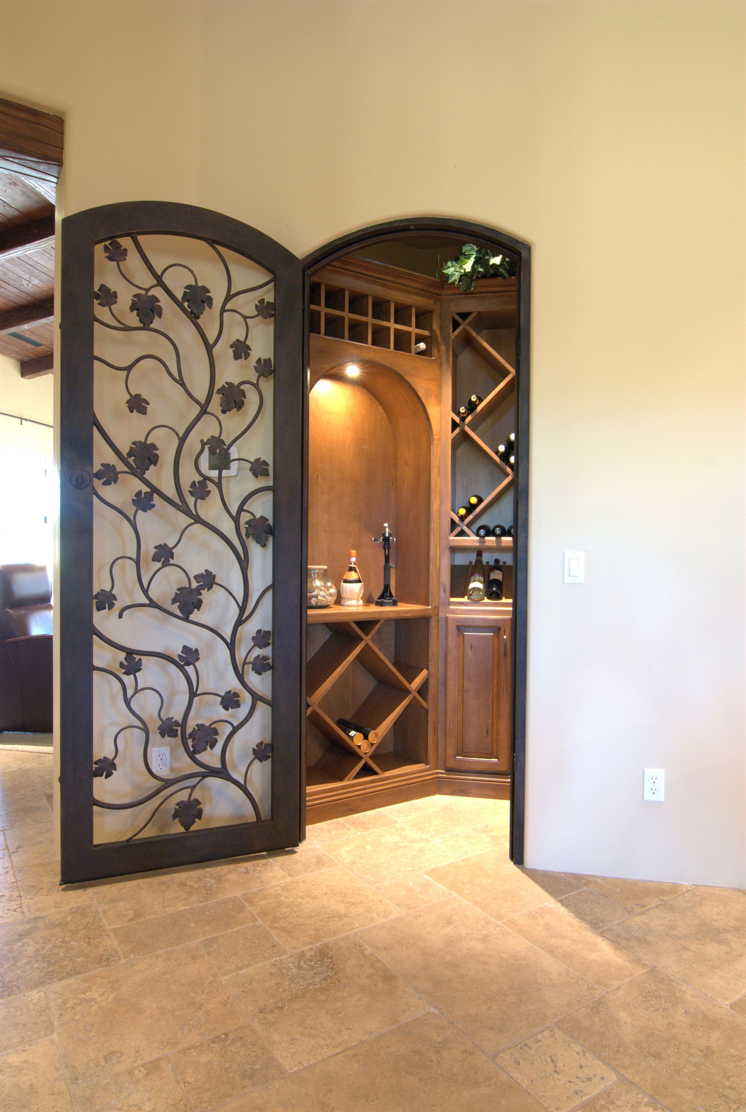 Walk-in wine closet with individual and bulk storage. This door is a ...