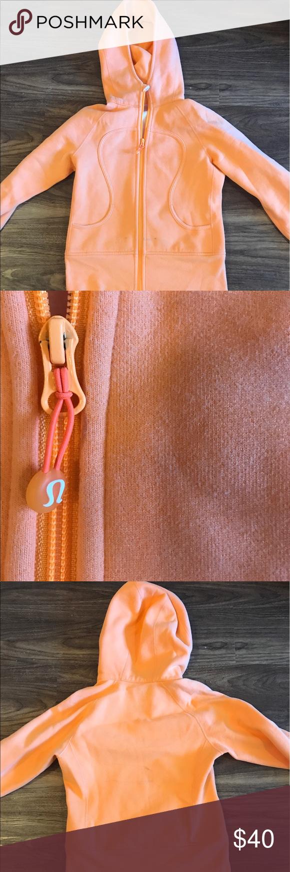 Lululemon Orange Hoodie Gently used orange Lululemon hoodie! Slight staining on the bottom front as shown in picture. lululemon athletica Tops Sweatshirts & Hoodies