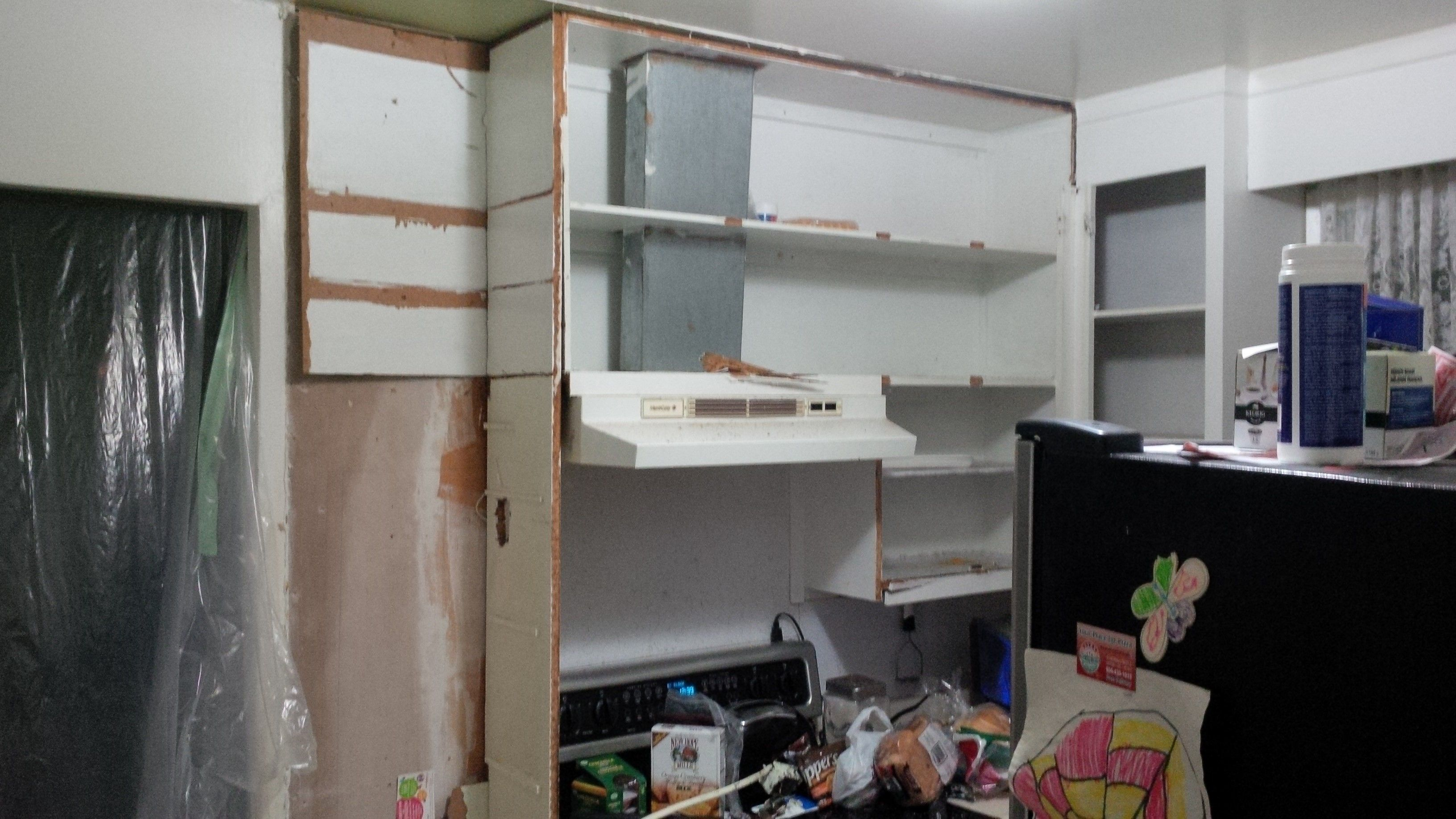 These weren't cabinets.  It was wood, with some doors on the front.