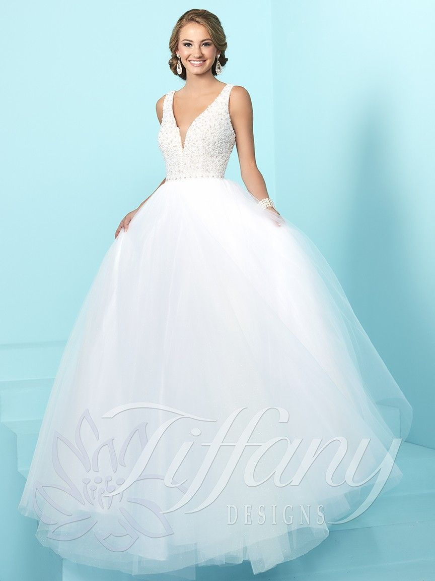 Say 'Yes' to Tiffany Designs 16241. This enchanting ball gown will leave your loved ones speechless. The fitted bodice is intricately beaded with pearls, and features a plunge, illusion, V-neckline, sheer modesty panel, tank straps, and an open, subtle, V-shaped back. This ball gown features a full, A-line skirt, that flows into a sweep train, with layers upon layers of classic tulle. Make a breathtaking entrance in this gown at your wedding, or debutante ball.
