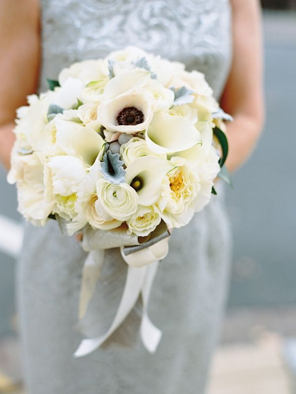 romantic moody bouquet featuring calla lilies, ranunculus, roses, dusty miller and silver brunia by Holly Chapple Flowers