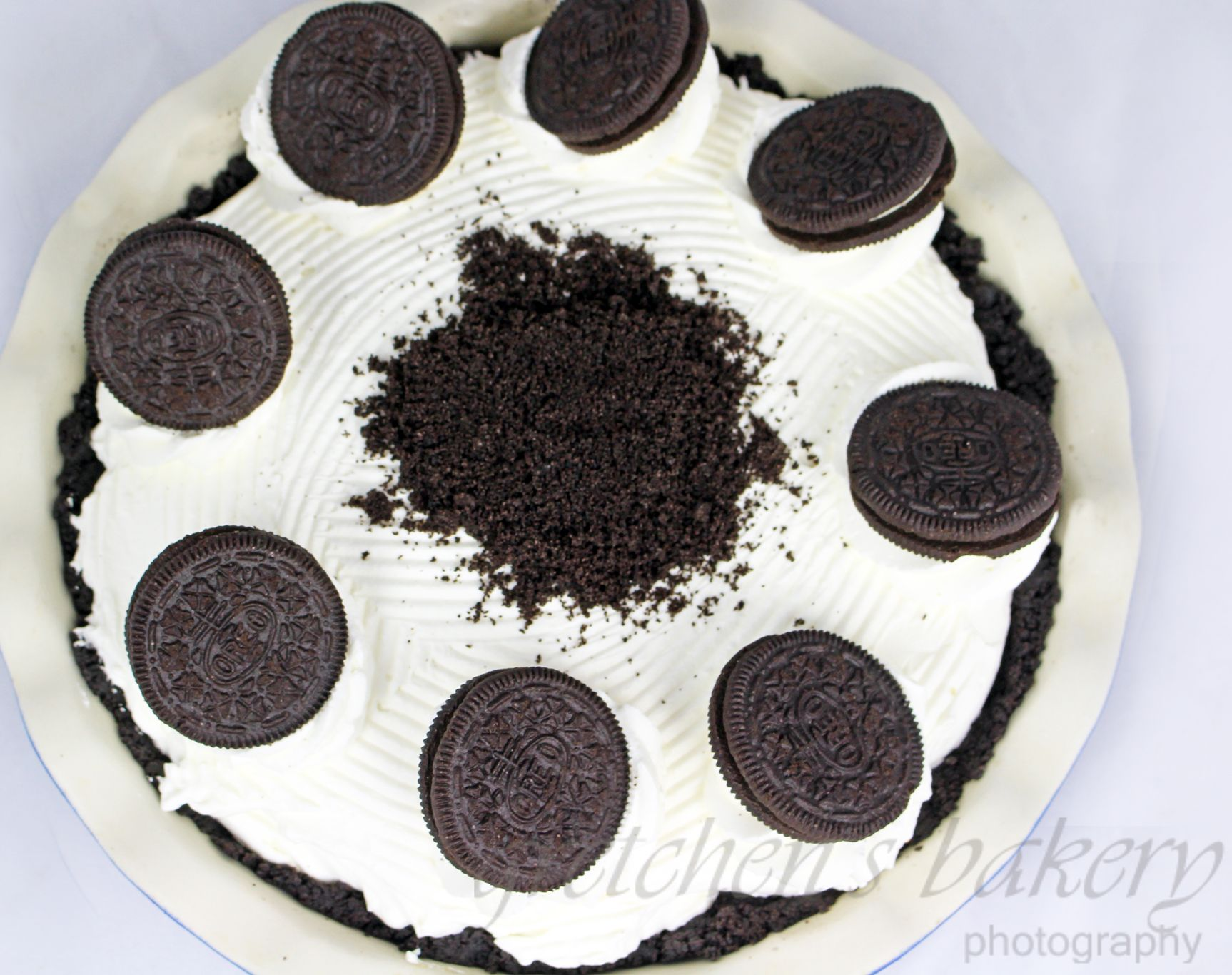 NO BAKE Chocolate Cream Pie with Oreo Crust and homemade chocolate custard piled high with whipped cream. This is a pie you can make in under 2 hours