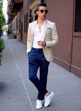 A Beige Suit Jacket And Dark Blue Dress Pants Will Showcase Your