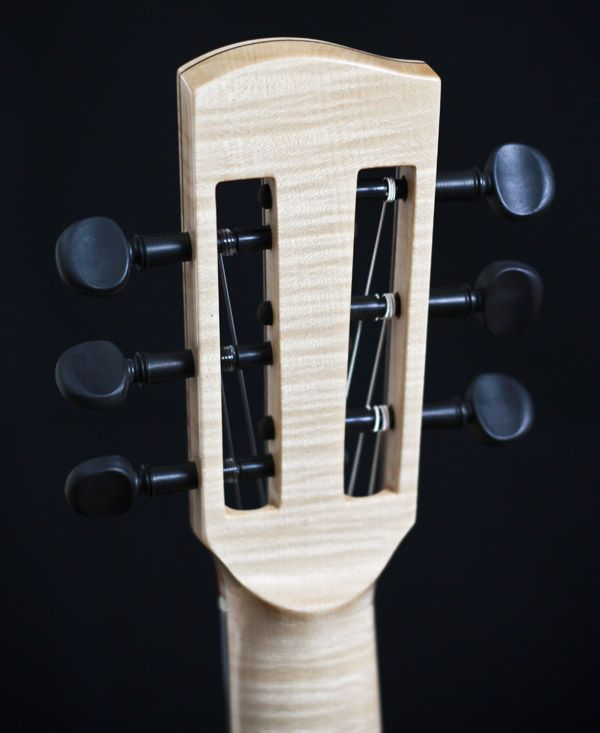 Batson Guitars headstock with wooden pegs
