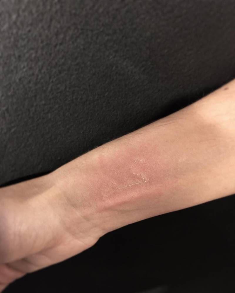 White ink leo constellation tattoo on the right inner wrist. Tattoo ...