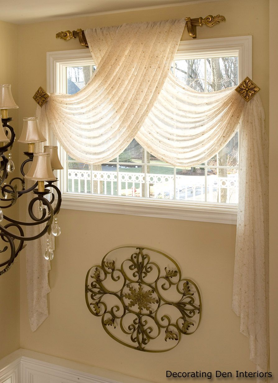Window above bed  sheer swag panelsbut look at the scroll design bet you could