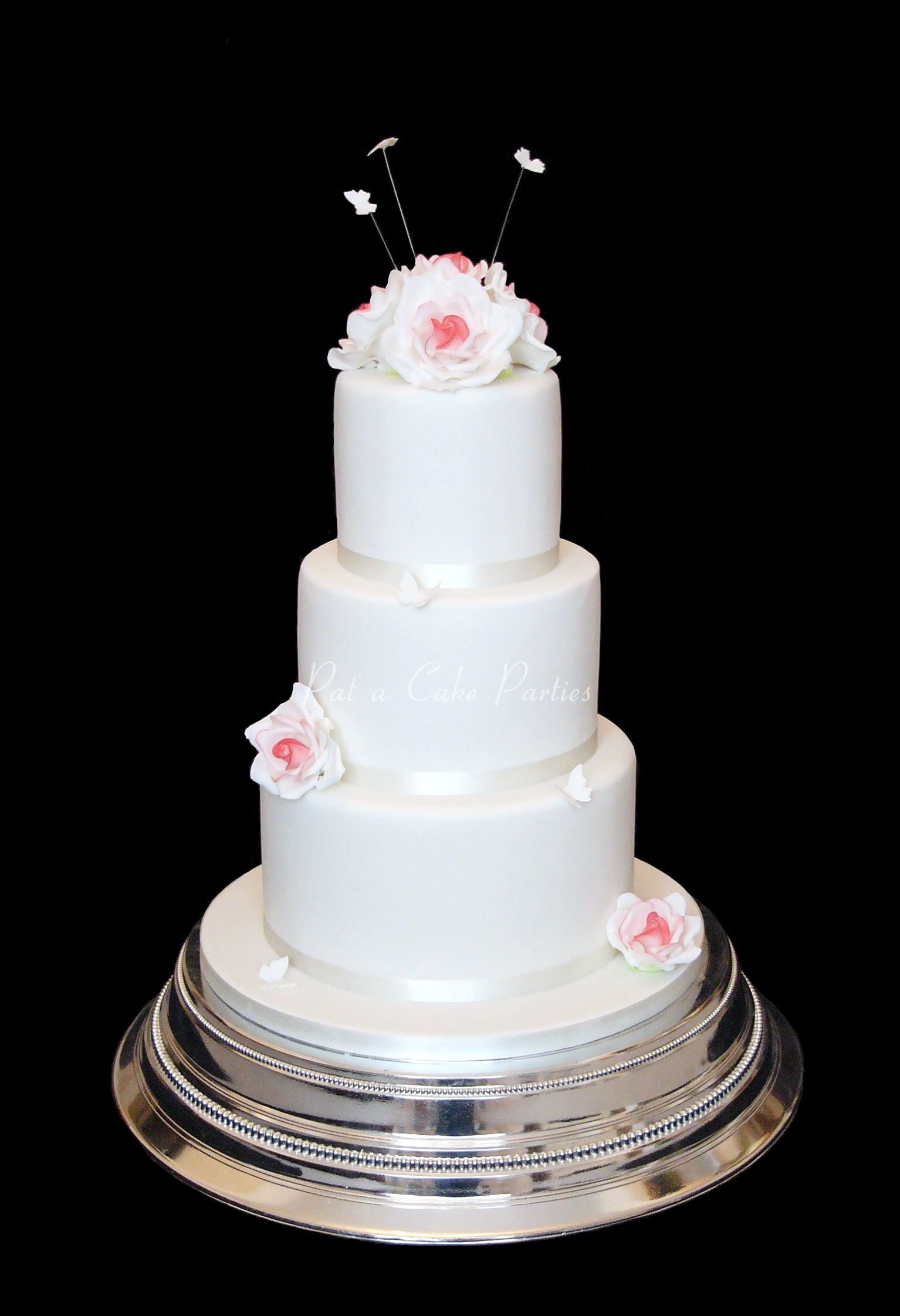 Less is more, with this elegant 3 tier wedding cake, finished with ...