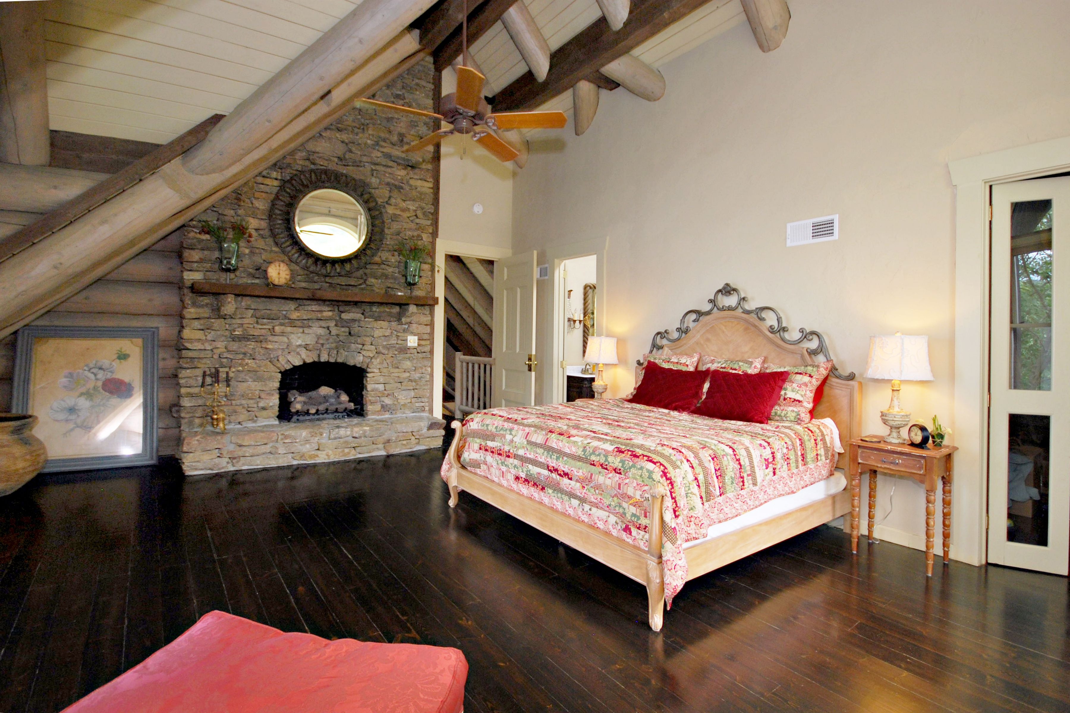 Master bedroom fireplace  Vaulted ceilings a stacked stone gaslog fireplace spa bath and a