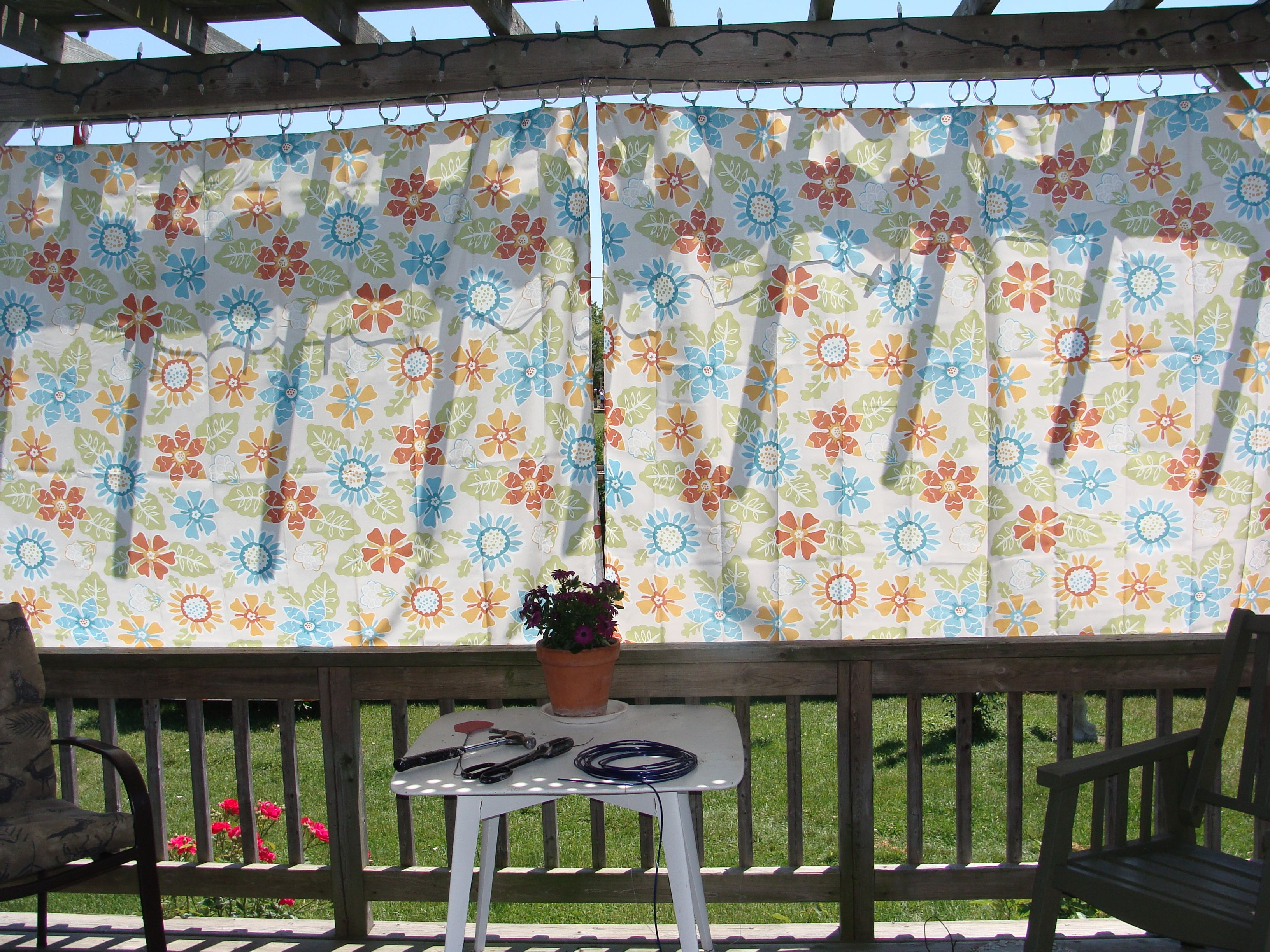Outside window treatment ideas  using tablecloths to cover the clothesline outside andor for patio