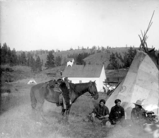 four men resting beside a tipi  ca  1905 nespelem district