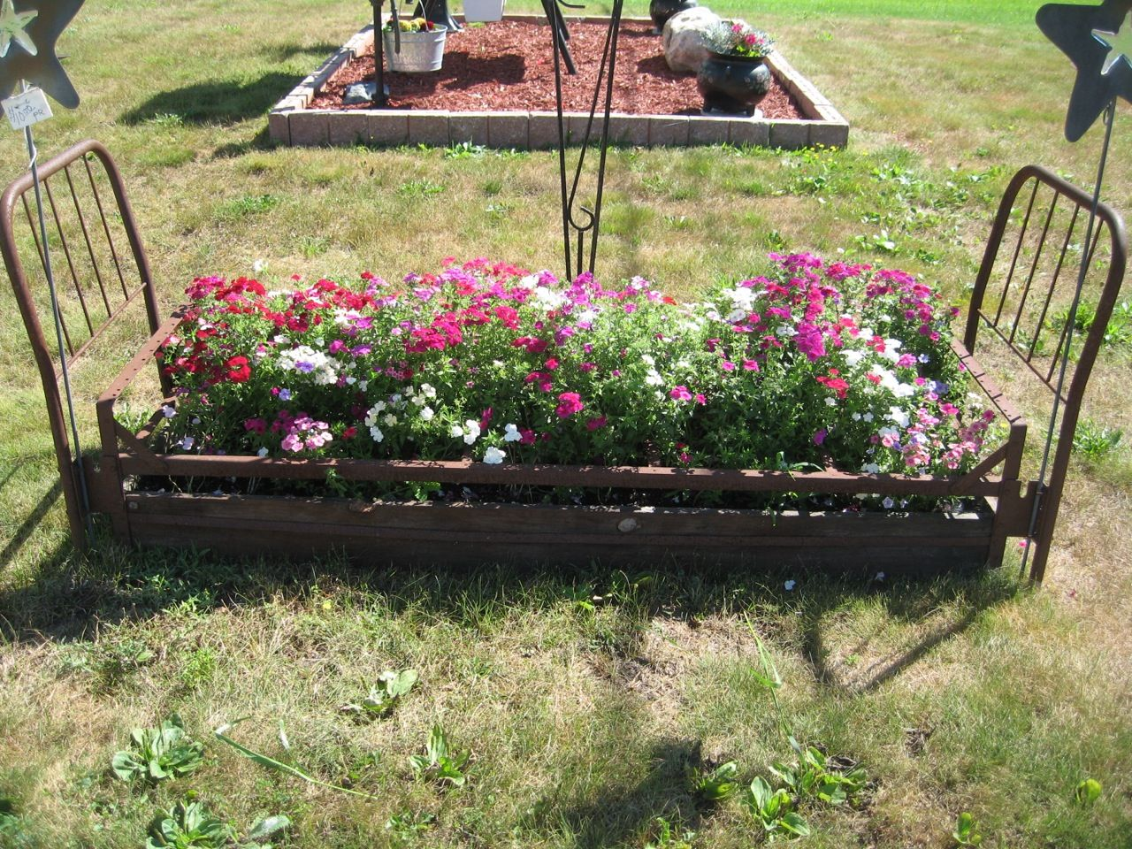 Flower bed in our front yard flower beds pinterest for Front yard flower beds