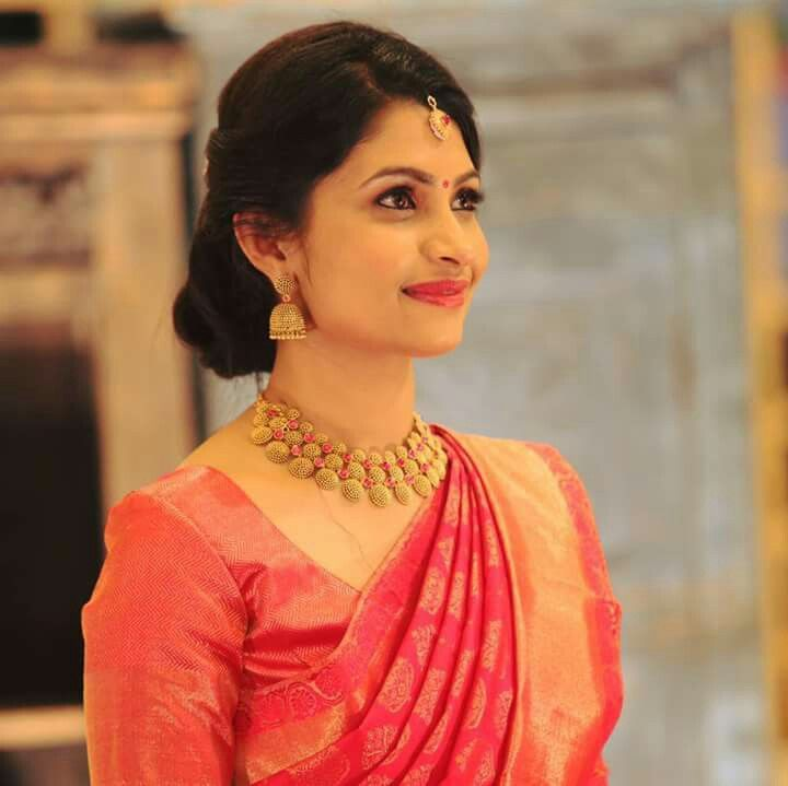 Drooling over her jewellery.   Christian wedding sarees, Indian bridal hairstyles