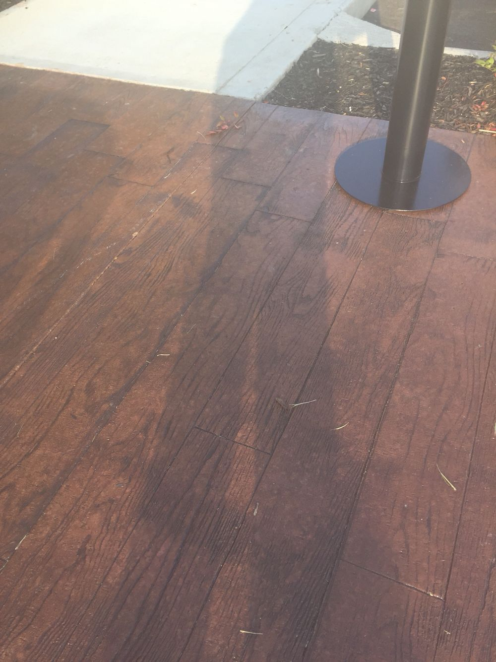 Concrete stamped and stained that looks like wood