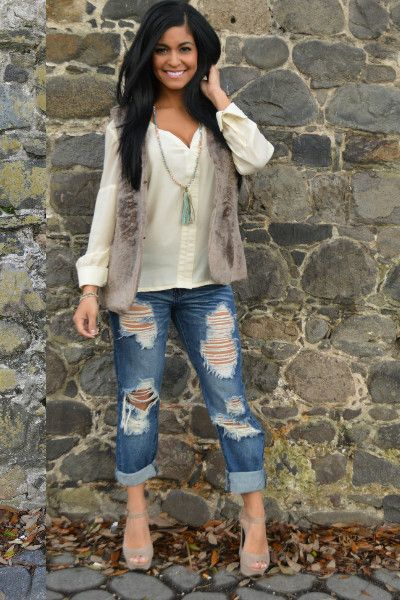 Faux Fur Vest -  TaupeFur Vest is comfy, comfy not to mention stylish! Faux Fur vest should be in every fashionistas closet, it is a stunning staple piece.   Side Pockets  Vest is fully lined  50% Cotton 50% Poly  Machine Wash