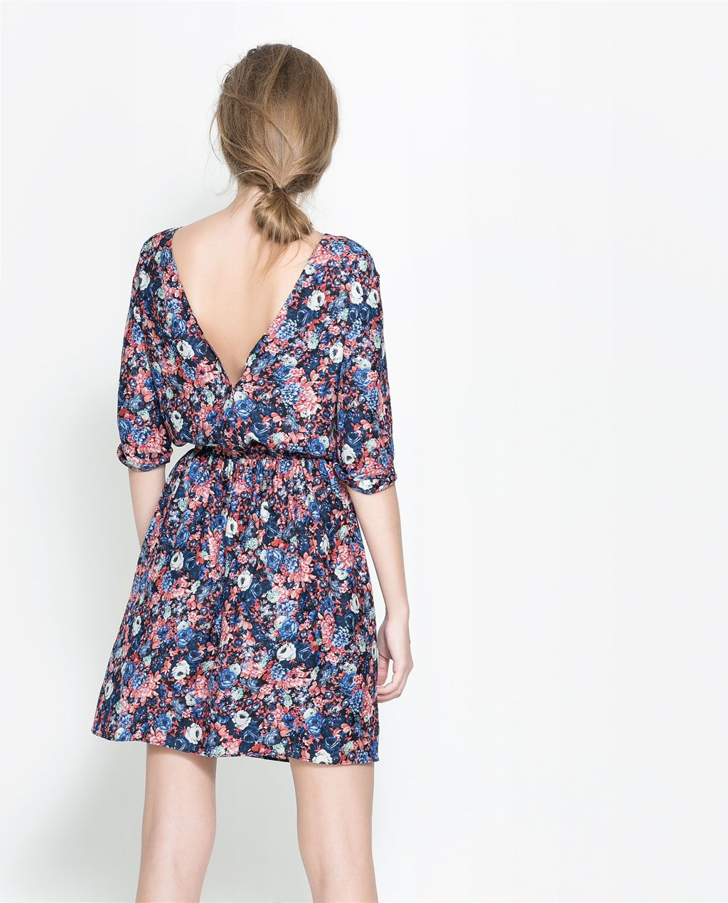 FLORAL DRESS WITH BUTTONS AT THE BACK