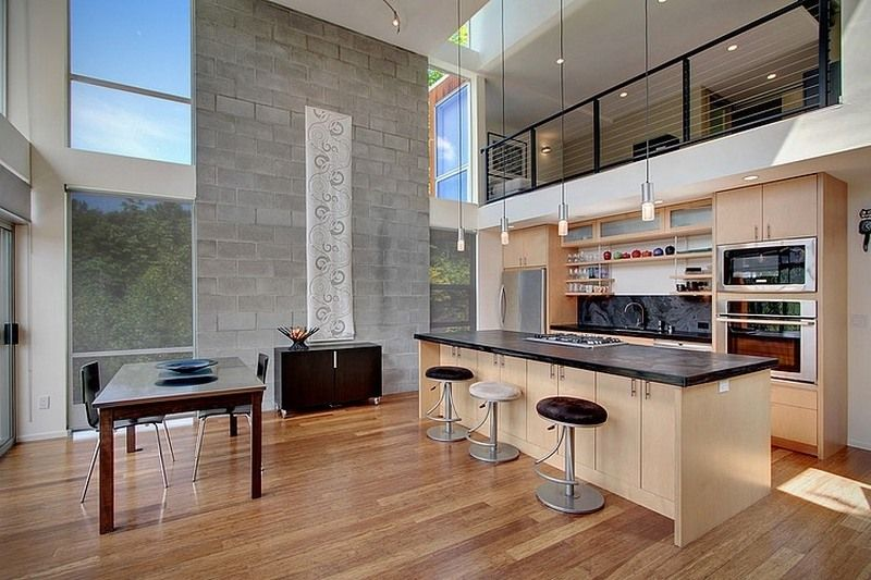 Modern Kitchen And Dining Room With A High Ceiling