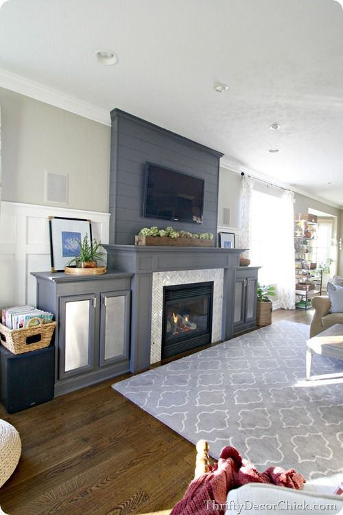 Finished living room complete with a beautiful gray fireplace and convenient built-ins
