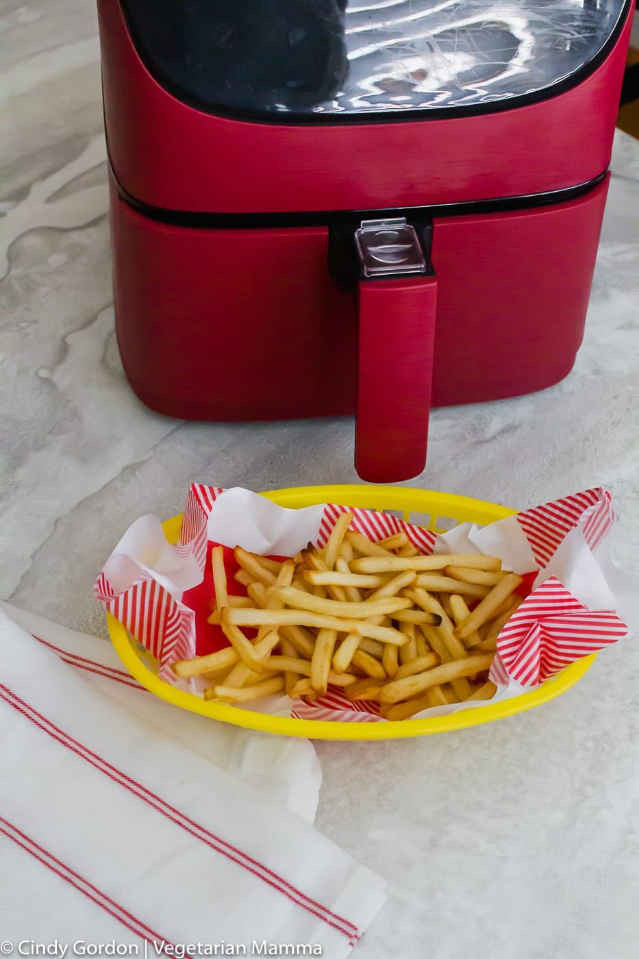 Air Fryer Frozen French Fries vertical photo showing red