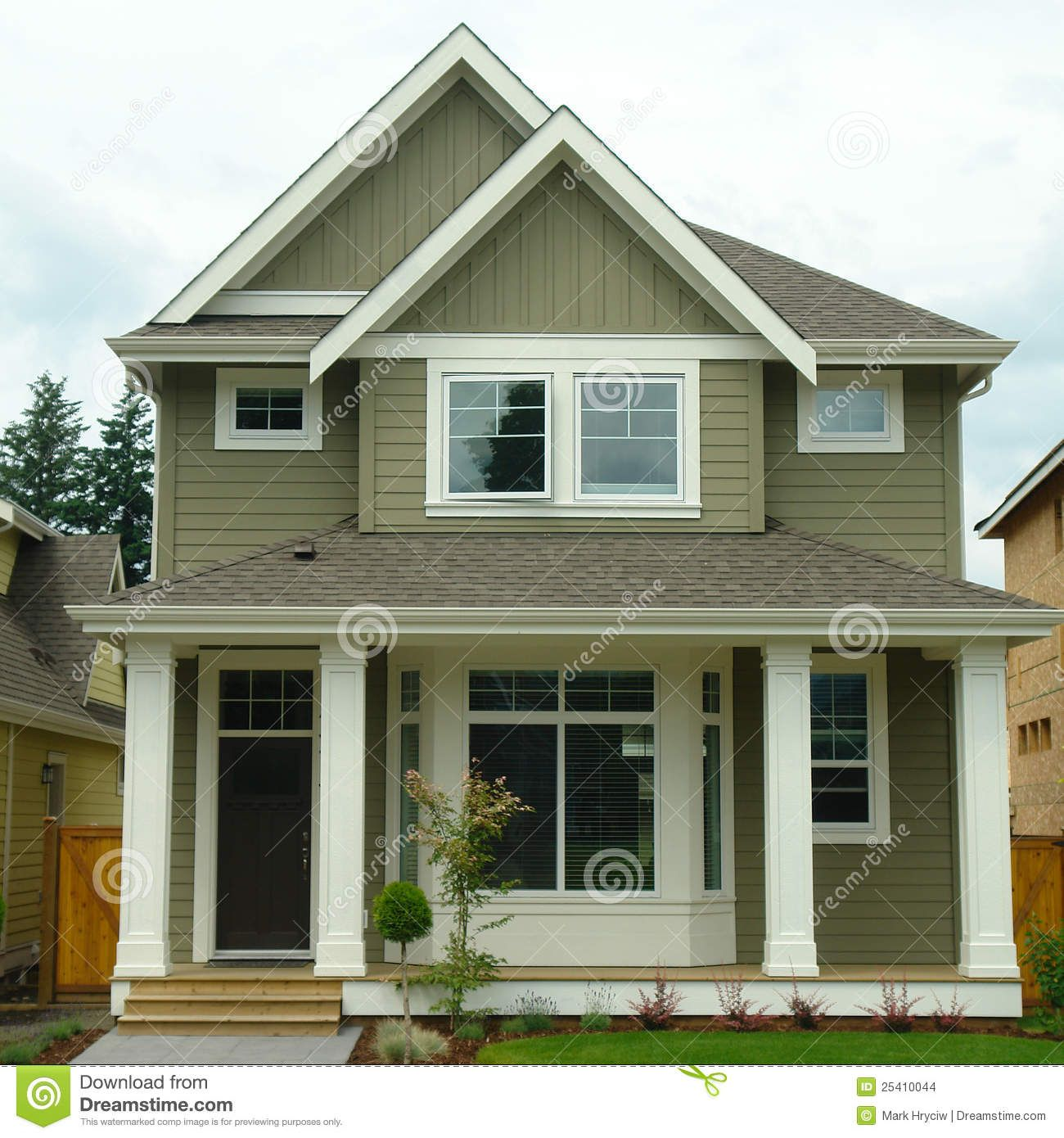 Forest green exterior house color new home house for Green home builders