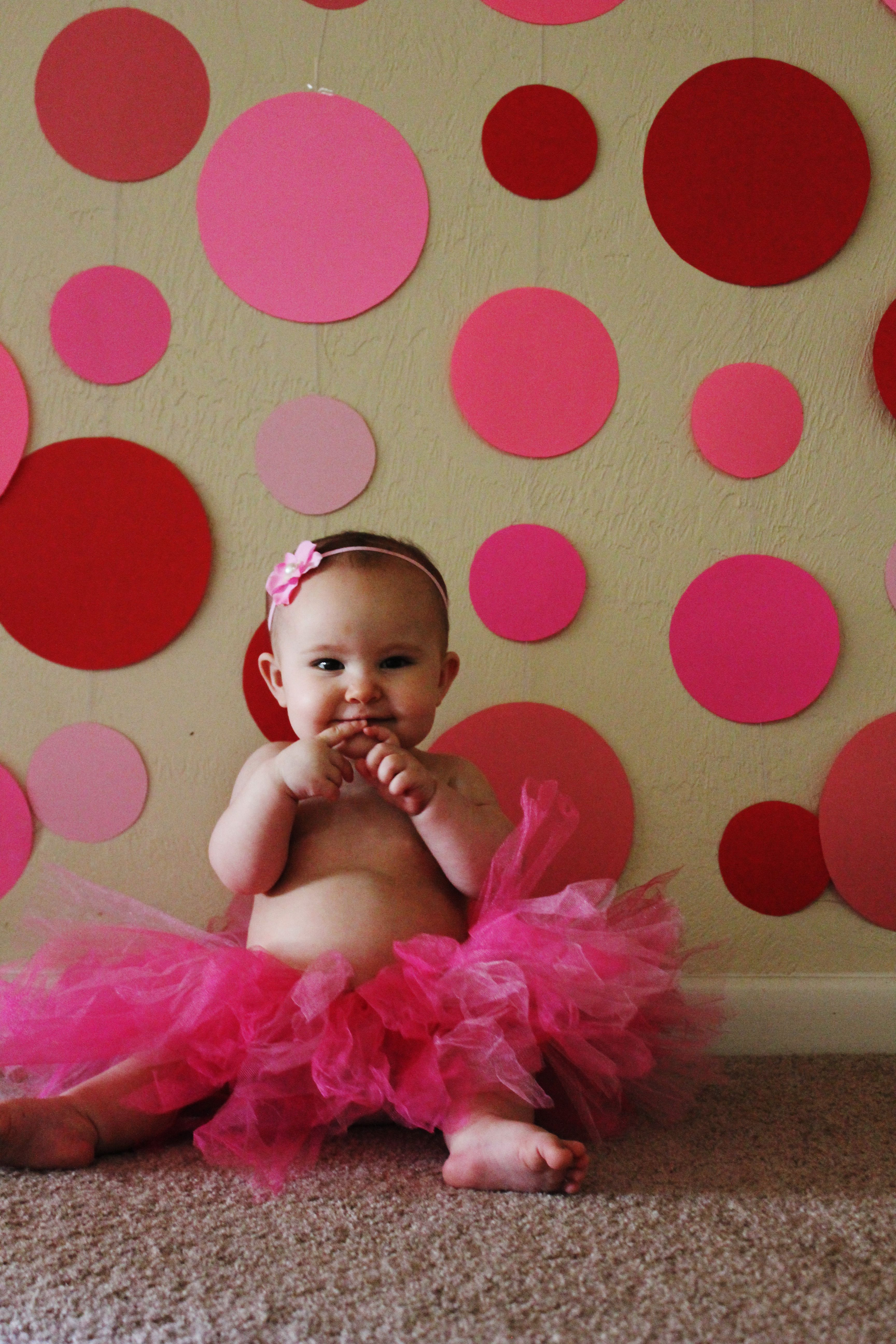 9c0017819 #baby #photography Make a fun backdrop with colored paper circles hung on  string for baby photos and Valentine's Day.