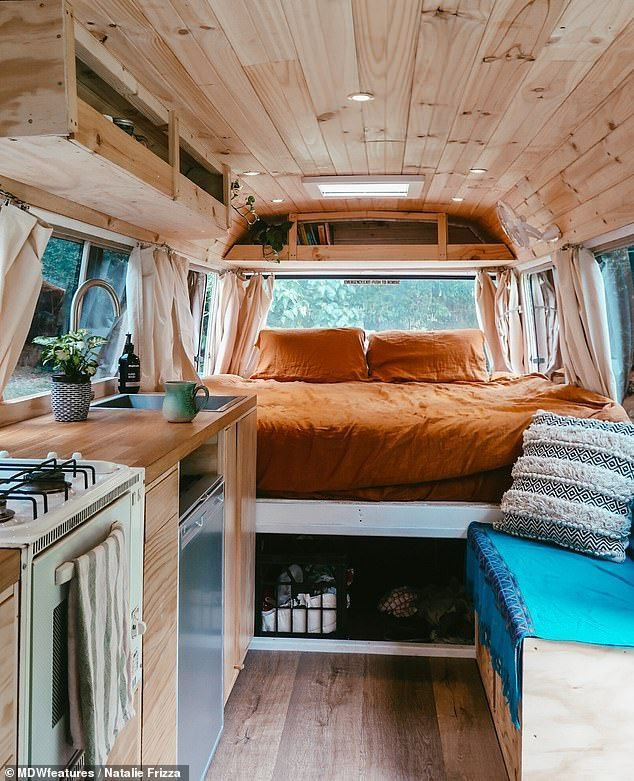 The interior of the bus is pictured, which shows the couple's kitchen and simple bedroom with stunn