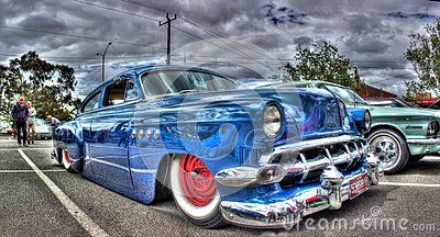 Classic 1950s blue Chevy that`s been lowered and custom painted at car show in Melbourne, Australia