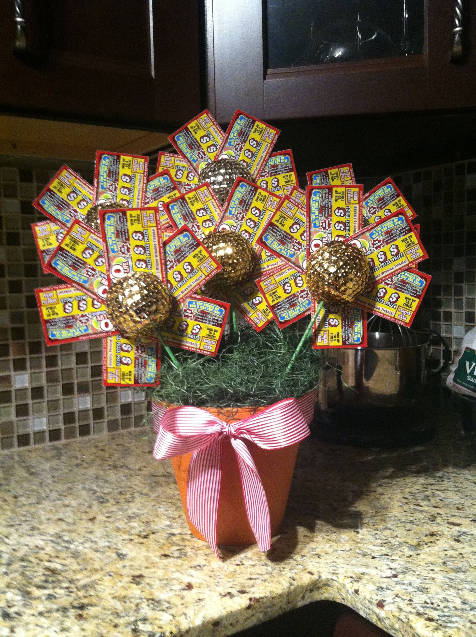 Lottery ticket flower pot. i see a christmas present for the boss ...