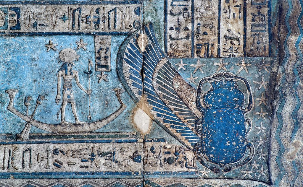 [EGYPT 29536] 'Setting of the sun in Hathor Temple at Dendera.' A winged setting sun is swallowed by the sky goddess Nut on the astronomical ceiling in the outer hypostyle hall of the Hathor Temple at Dendera. The ceiling consists of seven separate strips but here we are looking at the southern end of the EASTERNMOST STRIP. The entire strip is enveloped by the outstretched body of the sky goddess Nut but we only see the upper part of her body in this picture. The wave pattern on Nut's dress…