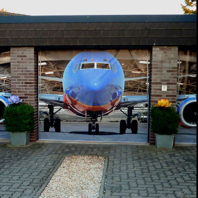 Pimp Up Your Garage Door With An Airplane Print Aviation