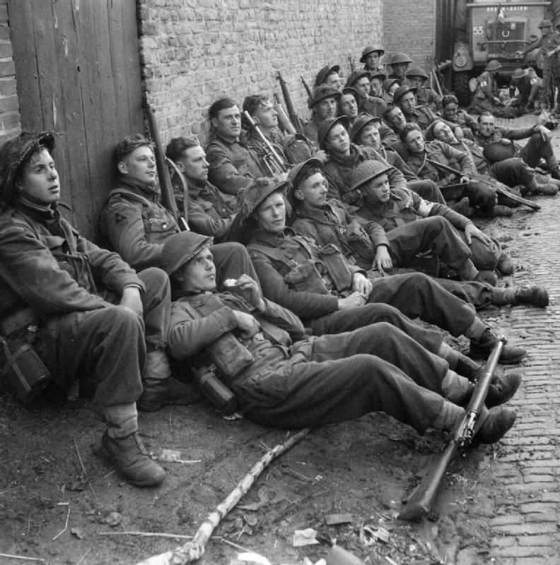 Men of the Royal Warwickshire Regiment rest in a Dutch village, 24 September 1944.
