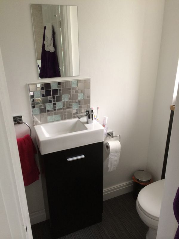 Ensuite Bathroom Suites Uk cloakroom vanity unit w/ glass blacksplash for a bathroom