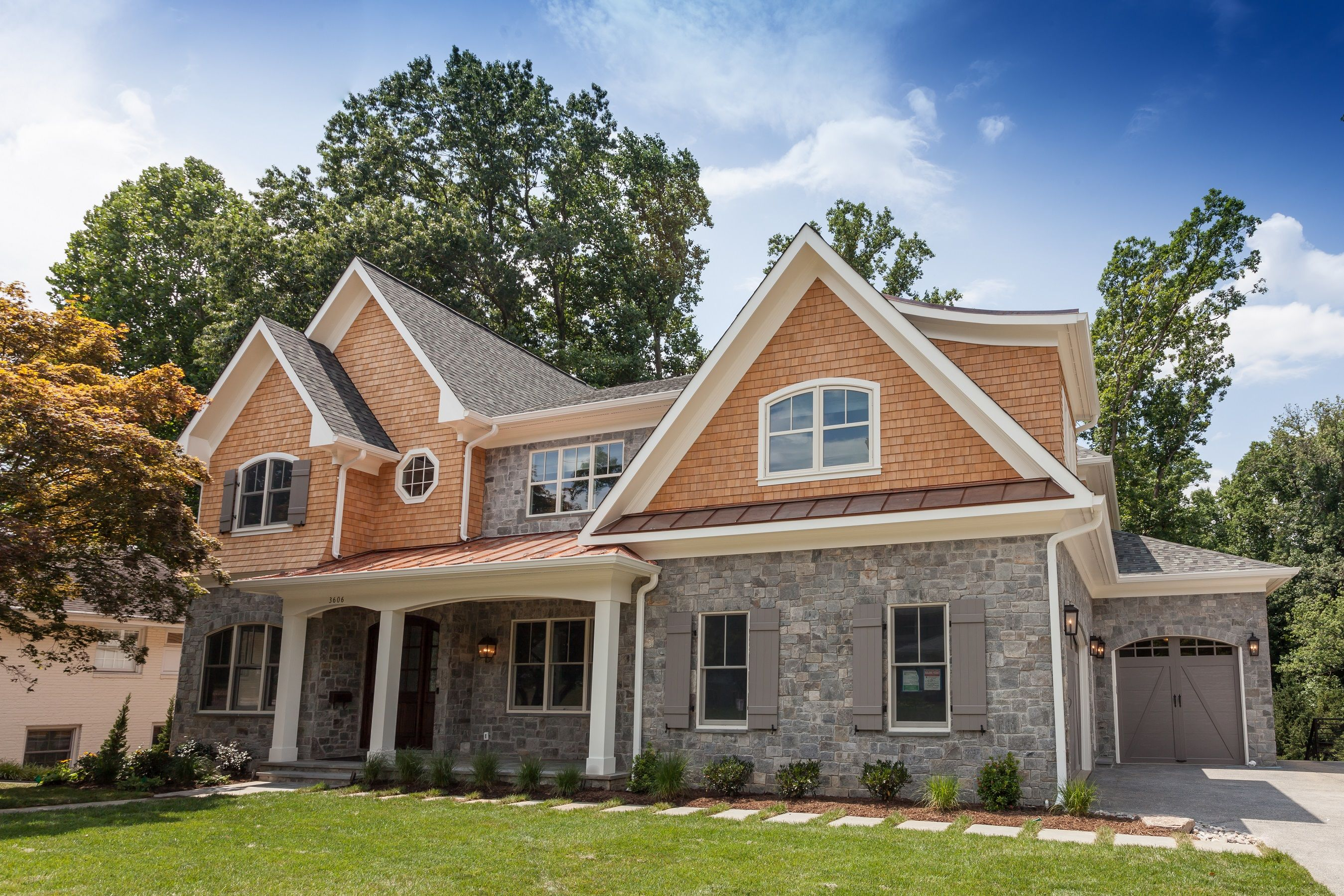 Tudor Farmhouse Inspired Exterior With Copper Porch Roof Stone Facade And Natural Cedar Shingle Sidin Ranch House Remodel Cedar Shingle Siding Shingle Siding