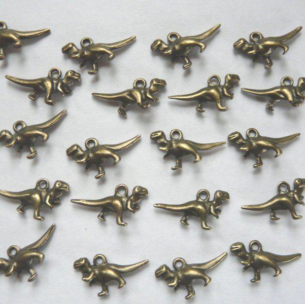 10 Antique Bronze Dinosaur Charms/Pendants €1.50
