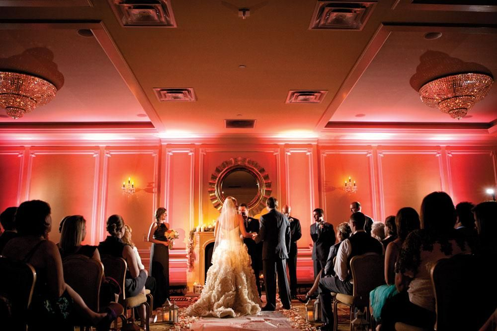 Pinkish coral uplighting creates the perfect ambiance for