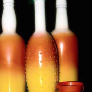 Spray painted bottles turned to candy corn by Kristy Scharenbroch