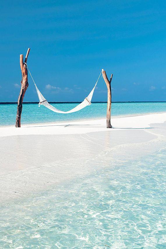 Hammock at tropical turquoise beach   Constance Moofushi Resort, Maldives via Vacation Idea