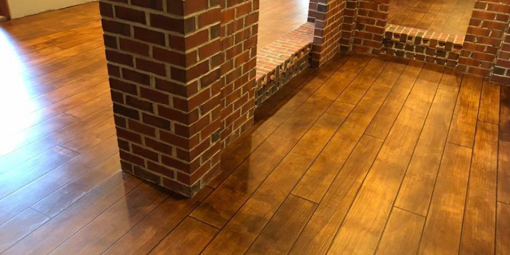 Amaze Your Guests With Our Woodcrete Flooring System All The Beauty Of Wood Floors Without The Worries To Learn Mor Basement Flooring Concrete Decor Flooring