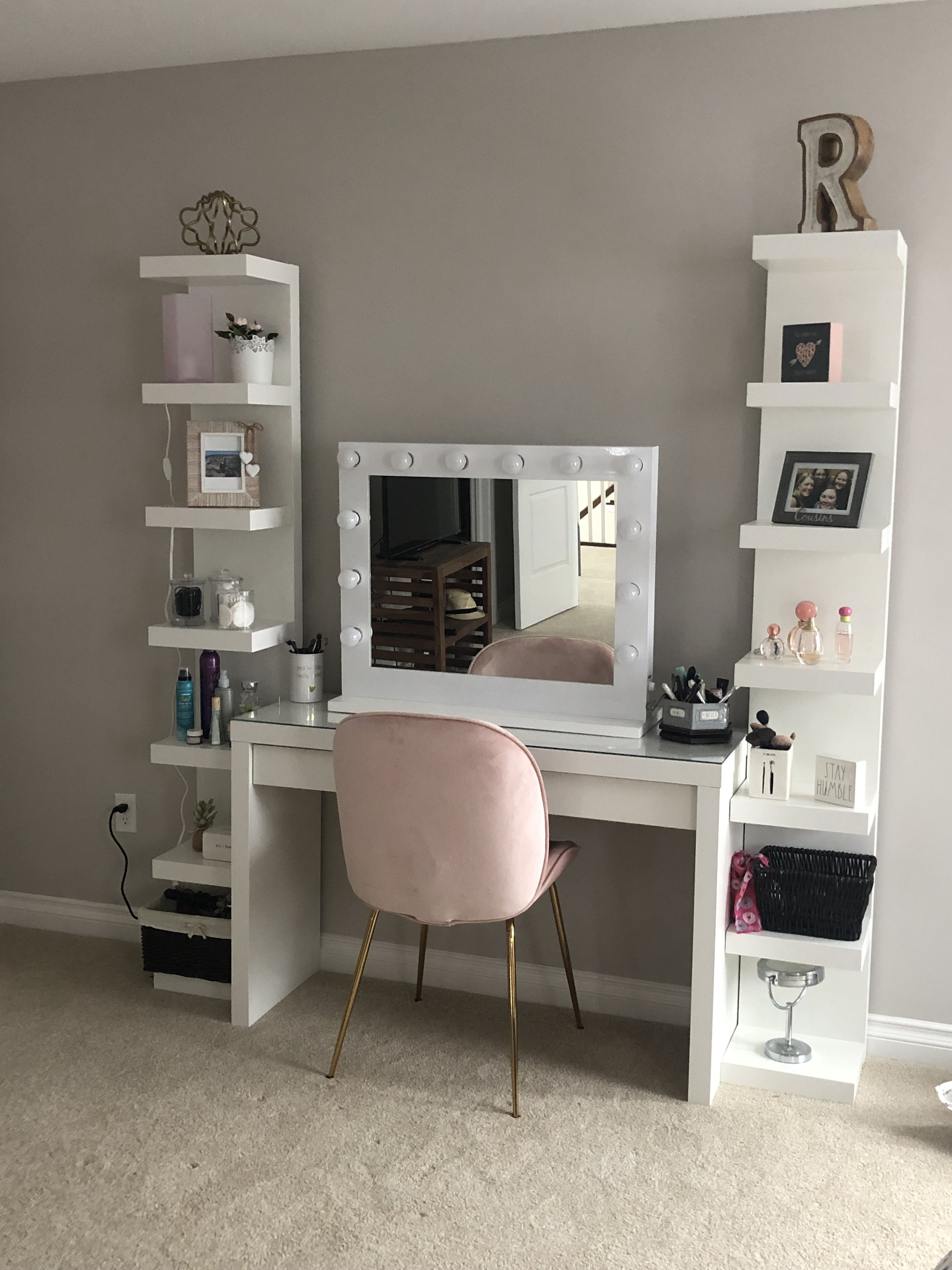 ikea desk with shelves and pink chair and mirror from